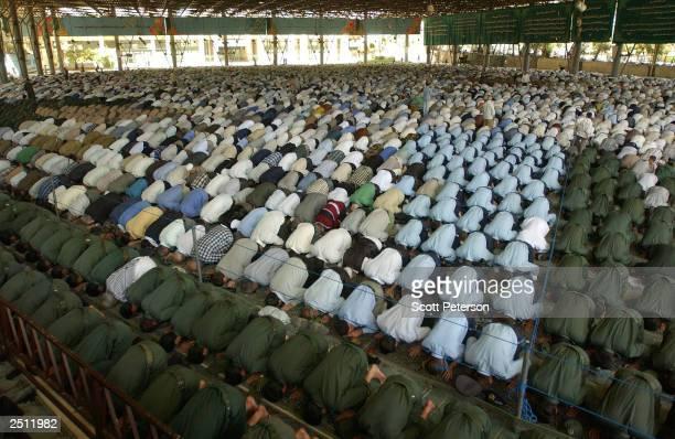Iran's Revolutionary Guards attend Friday prayers at Tehran University September 19, 2003 in Tehran, Iran. Embroiled in internal battles between...