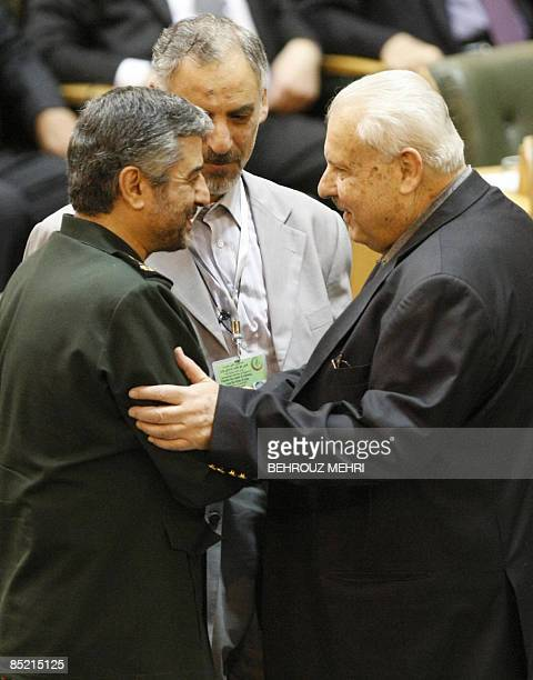 Iran's Revolutionary Guards commander Mohammad Ali Jafari shakes hands with Palestinian ambassador to Iran Salah alZavavi during a conference in...