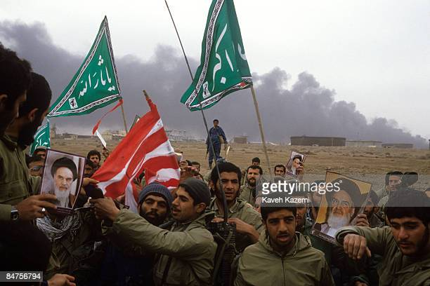 Iran's Revolutionary Guards prepare to burn an American flag on the alFao Peninsula after it was recaptured by Iranian forces from the Iraqi army...