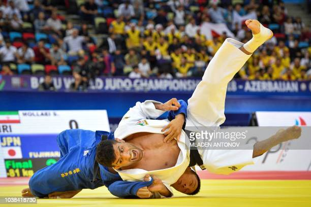 Iran's Saeid Mollaei fights with Japan's Sotaro Fujiwara in the men under 81kg category bout of the 2018 Judo World Championships in Baku on...