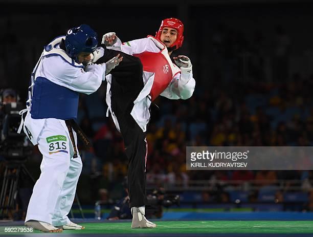 Iran's Sajjad Mardani competes agaisnt Tonga's Pita Nikolas Taufatofua during their men's taekwondo qualifying bout in the 80kg category as part of...