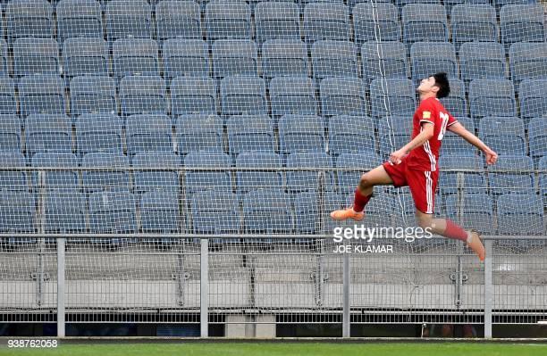 TOPSHOT Iran's Sardar Azmoun celebrates scoring during the international friendly football match between Iran and Algeria at the Merkur Arena in Graz...