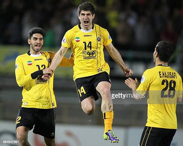 Iran's Sepahan forward Xhevahir Sukaj and his teammates Ali Karimi and Ehsan Hajisafi celebrate after scoring a goal against Qatar's AlSadd during...