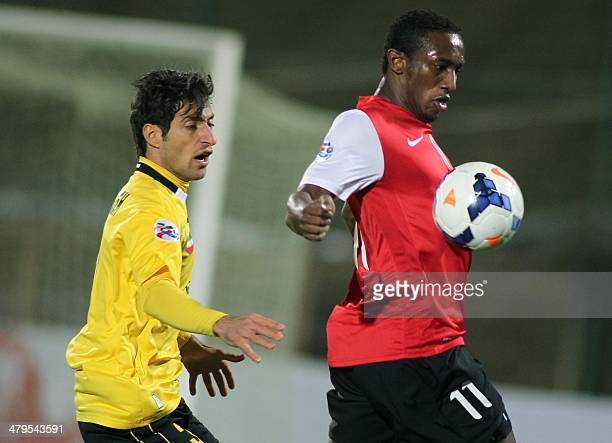 Iran's Sepahan Shojae Khalilzadeh fights for the ball against UAE alAhli's Ahmed Khalil during their AFC Champions League group D football match at...