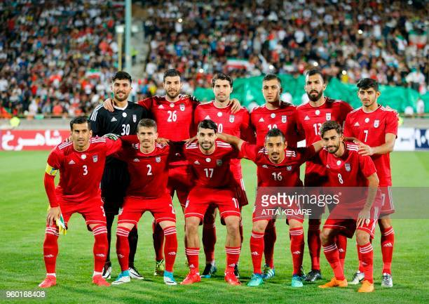 Iran's starting eleven lineup for a group picture ahead of their international friendly match against Uzbekistan at Tehran's Azadi Stadium on May 19...