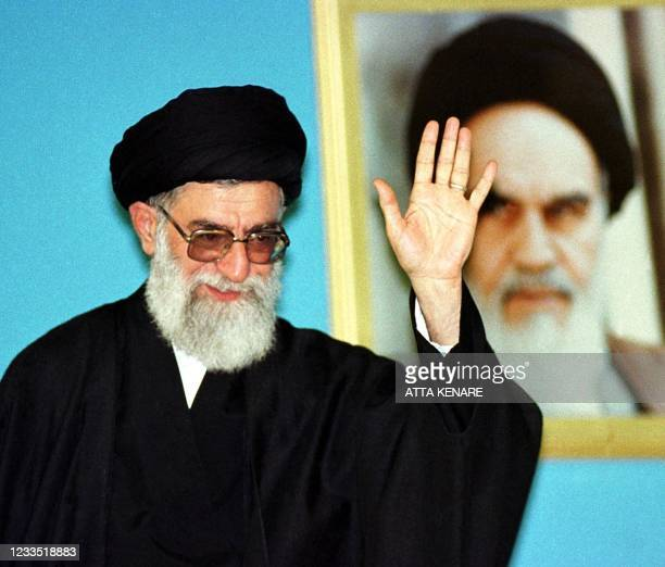 Iran's supreme leader Ali Khamenei salutes military officials on the national Army Day in Tehran 17 April 2000. The outgoing Iranian parliament...