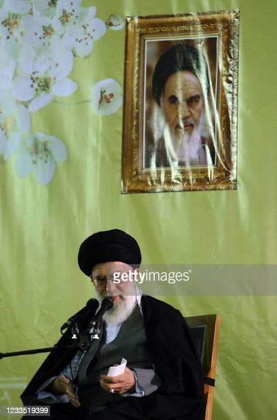 Iran's Supreme leader Ayatollah Ali Khamenei delivers a speech under a portrait of Iran's late founder of the Islamic Republic, Ayatollah Ruhollah...