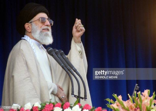 Iran's supreme leader Ayatollah Ali Khamenei delivers the Eid al-Fitr prayer sermon at Tehran's Imam Khomeini Mosala 16 December 2001. Iranians,...