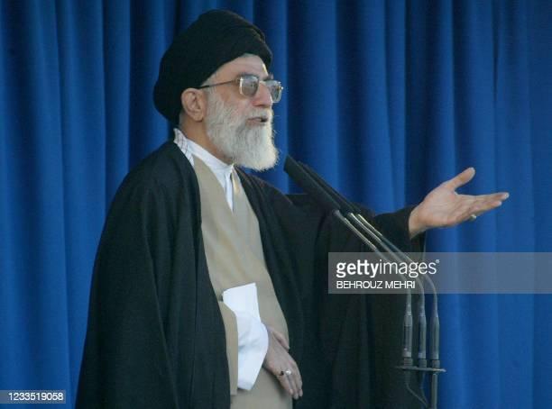 Iran's Supreme leader Ayatollah Ali Khamenei delivers the Friday prayer sermon 14 November 2003 in Tehran's grand mosque of Imam Khomeini , for the...