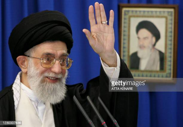 Iran's supreme leader Ayatollah Ali Khamenei delivers the sermon of the weekly Friday prayers, with a portrait of the late founder of the Islamic...