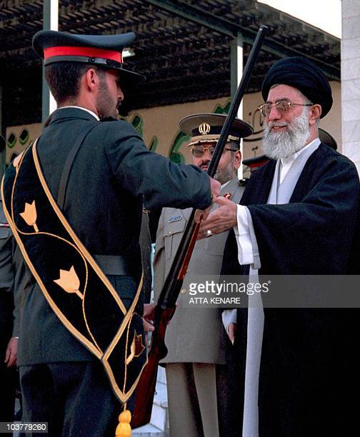 Iran's Supreme Leader Ayatollah Ali Khamenei greets a policeman during a parade marking Police Week in Tehran 09 October 2000 The event included a...
