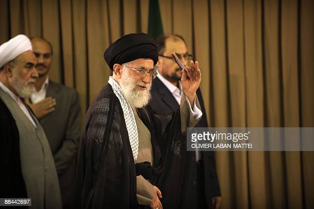 Iran's Supreme Leader Ayatollah Ali Khamenei leaves the polling station after casting his vote to elect a new president at his office in Tehran on...