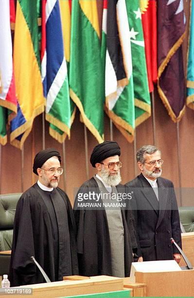 Iran's supreme leader Ayatollah Ali Khamenei President Mohammed Khatami and Foreign Minister Kamal Kharazi listen to the national anthem 09 December...