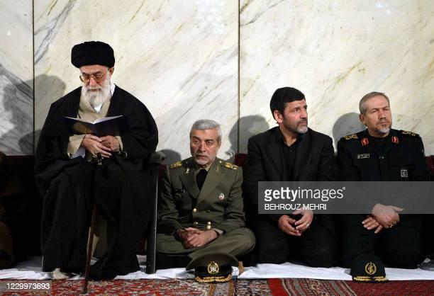 Iran's supreme leader Ayatollah Ali Khamenei reads the Koran as he sits next to Iranian officials Iran's Revolutionary Guardians Cheif, Yahya Rahim...