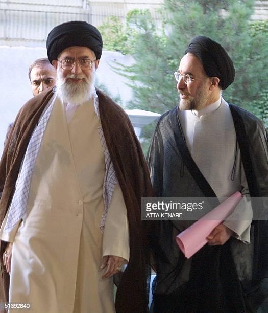 Iran's Supreme leader Ayatollah Ali Khamenei receives President Mohammad Khatami outside his office in Tehran 27 August 2001. Khatami, who was...