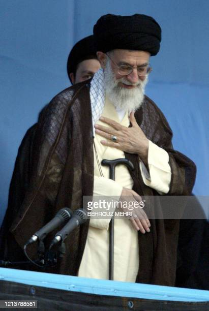 Iran's Supreme Leader Ayatollah Ali Khamenei salutes as he addresses Iranians during the commemoration of the 16th anniversary of the death of...