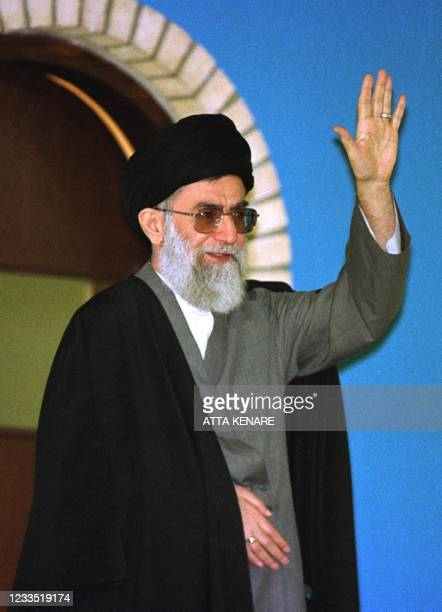 Iran's supreme leader Ayatollah Ali Khamenei waves as he speaks to a large crowd gathered outside the Imam Khomeini mosque in Tehran 02 February...