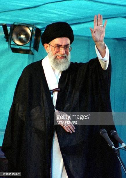 Iran's supreme leader Ayatollah Ali Khamenei waves to the tens of thousands of mourners at the mausoleum of Ayatollah Ruhollah Khomeini during the...