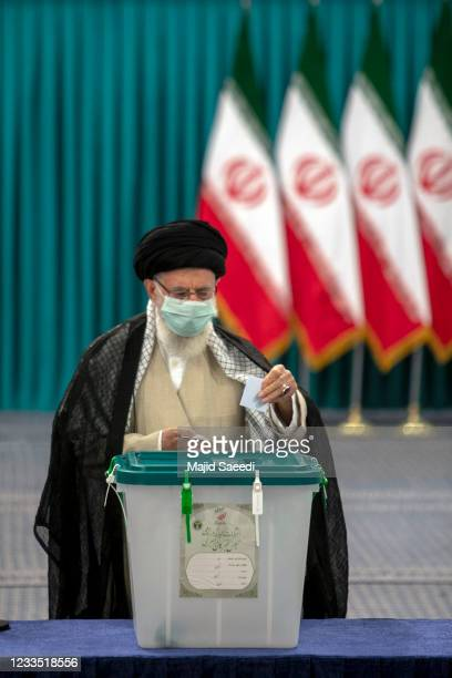Iran's Supreme Leader Ayatollah Ali Khamenei wears a face mask as he casts his ballot on June 18 on the day of the Islamic republic's presidential...