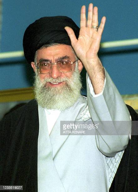 Iran's supreme leader Ayattolah Ali Khamenei waves at the crowd during a ceremony 12 November 2000 at Khomeini mosque in Tehran to celebrate the...