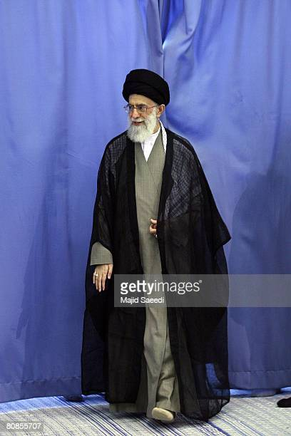 Iran's supreme religious leader Ayatollah Sayed Ali Khamenei arrives to vote at a polling station during the second round of parliamentary elections...