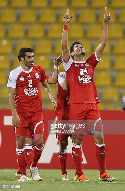 Iran's Tractor Sazi Tabriz player Farzad Rahmani celebrates with his teammates after scoring their second goal to win their Asian Champions League...