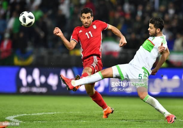 Iran's Vahid Amiri and Algeria's Farouk Chafai vie for the ball during the international friendly football match between Iran and Algeria at the...
