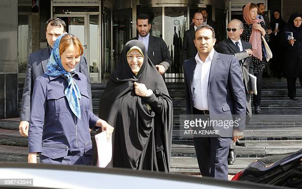 Iran's Vice President and Head of Environmental Protection Organization Masoumeh Ebtekar walks with French Ecology Minister Segolene Royal following...