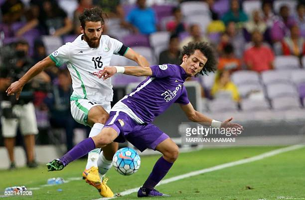 Iran's Zobahan's Ali Hamam fights for the ball with UAE's AlAin's Mohamed Abdulrahman during their AFC Champions League round 16 football match at...
