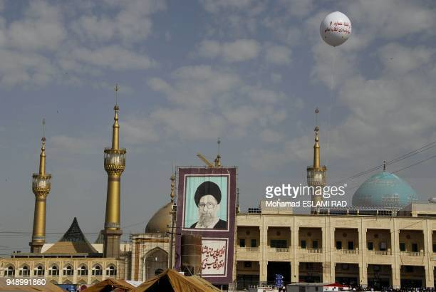 IranTehran June 4 2007 Khomeini's Shrine south of Tehran during 18th anniversary of his death with the banner of Iran's Sureme Leader Ali Khamenei