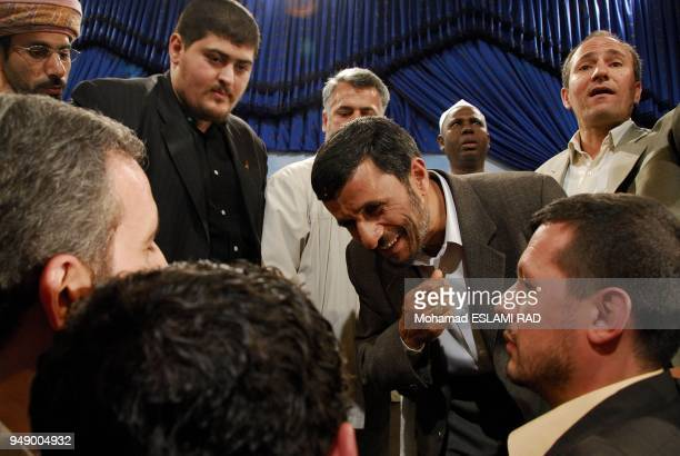 IranTehran June 52007 journalists covering the death anniversary of Ayatollah Khomeini gather to take pictures with Iran's President Mahmoud...