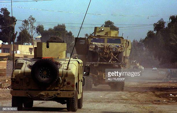 A damaged US Humvee is carried away on a flatbed truck after being struck by suicide car bomb in the city of Baquba northeast of Baghdad 28 November...
