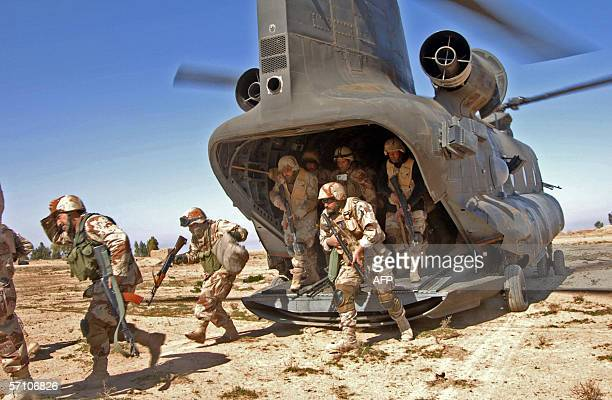 A picture released by the US Army 16 March 2006 shows Iraq soldiers walking out from a US helicopter somewhere north of Baghdad during Operation...