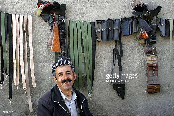 A salesman displays gun accessories at 09 December 2005 at a blackmarket in the northern Iraq Kurdish city of Suleimaniya More than 220 separate...