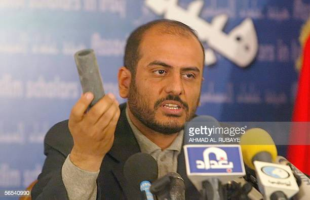 A spokesman for the Sunni Muslim Scholar's Association Muthana Harith alDhari holds up a sound grenade during a press conference at the Umm alQura...