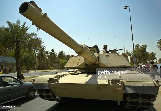 A US M1 Abrams tank is stationed on a street as Delta Company of Task Force 464 Armor operate a Traffic Control Point mission as part of Operation...