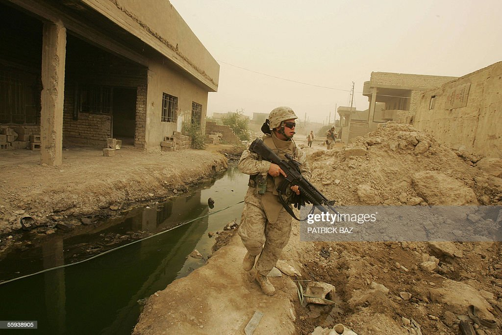A US marine from the 6th Civil Affairs Group 2nd Marine Expeditionary Force (MEF) patrols the southern part of the city of Fallujah, west of Baghdad, 17 October 2005. More than 60 percent of the population returned to the city devastated by heavy combats between US marines and insurgents in November 2004. About 70 insurgents were killed in US air strikes in the Ramadi region of western Iraq, where five US and two Iraqi soldiers were killed in a weekend roadside bombing, the US military said today.