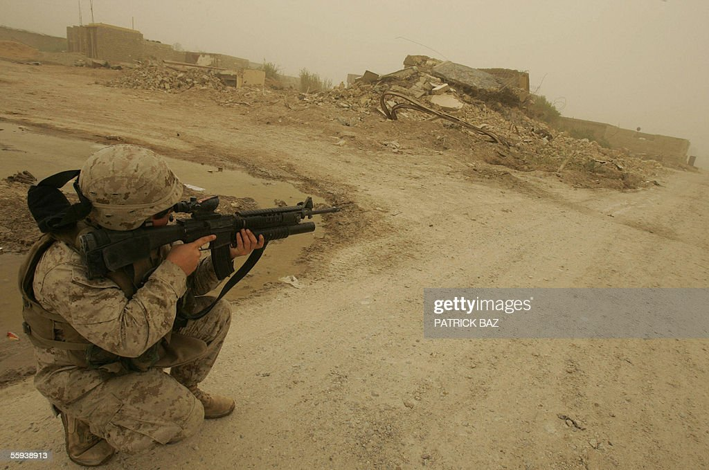 A US marine from the 6th Civil Affairs Group 2nd Marine Expeditionary Force (MEF) takes position in a street as he patrols the southern part of the city of Fallujah, west of Baghdad, 17 October 2005. More than 60 percent of the population returned to the city devastated by heavy combats between US marines and insurgents in November 2004. About 70 insurgents were killed in US air strikes in the Ramadi region of western Iraq, where five US and two Iraqi soldiers were killed in a weekend roadside bombing, the US military said today.