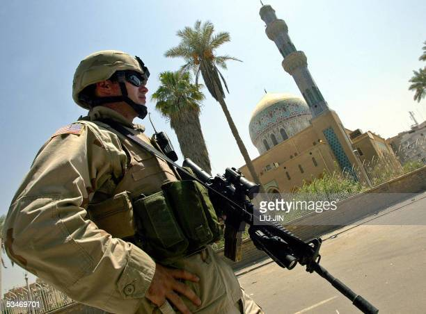A US soldier of Delta Company of Task Force 464 Armor keeps eyes on streets next to the Ramadan Mosque during a patrol in Baghdad 26 August 2005...