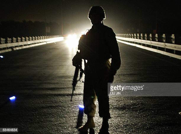 A US soldier of Delta Company of Task Force 464 Armor patrol on the AlDora Bridge in Baghdad late 25 August 2005 US President George W Bush...