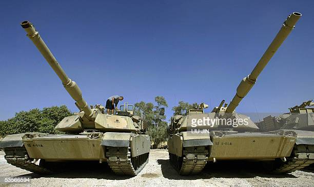 A US soldier of Delta Company Task Force 464 Armor works on the M1 Abrams Tanks at Camp Prosperity in Baghdad's fortified Green Zone 31 August 2005...