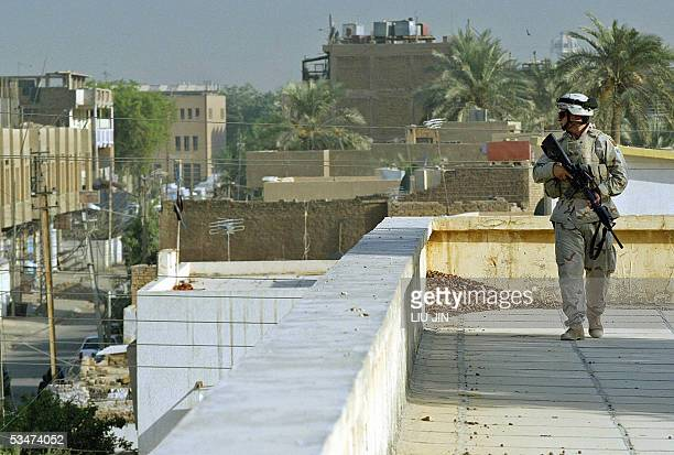 A US soldier secures on the roof when the Delta Company and 1st team 425th Civil Affairs Company of Task Force 464 Armor operate the School Supplies...
