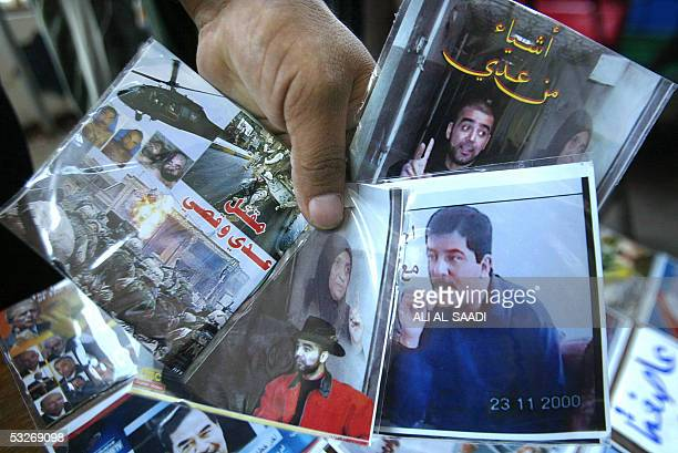 A vendor displays a few DVD's showing old footage of ousted dictator Saddam Hussein's sons Uday and Qusay on the second anniversary of their death 22...