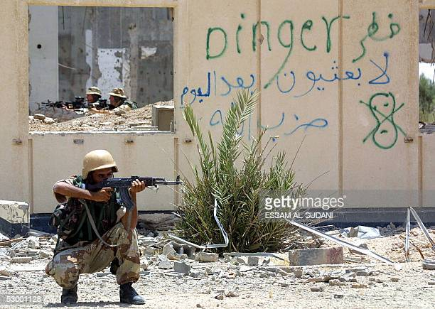 An Iraqi and British soliders take part in a training session at the Zubair army base a few kilometers form the southern city of Basra 500kms from...