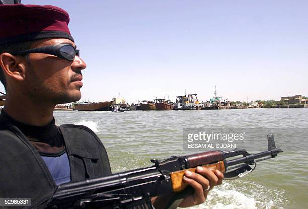 An Iraqi border police officer patrols the Abu al-Khasieb waterway, 30kms south of the city of Basra, 500 kms from Baghdad 22 May 2005. Border police...