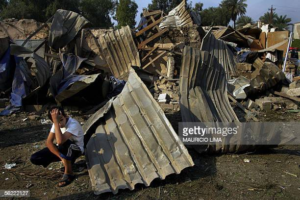 An Iraqi boy shows his dejection in front of his destroyed house at the site where two suicide bombers detonated explosivesladen cars near Al Hamra...