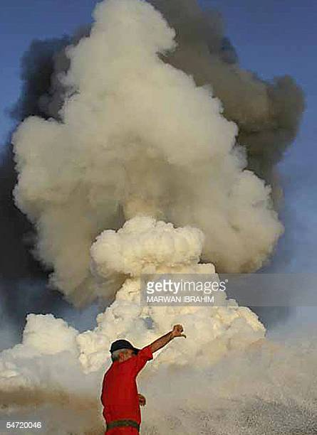 An Iraqi fireman extinguishes fire 05 September 2005 two days following a rebel attack on a major pipeline west of the oil center of Kirkuk Iraqi oil...