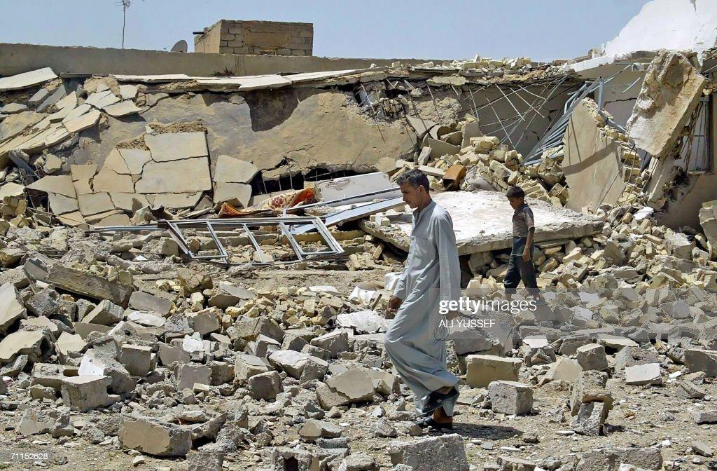 An Iraqi man walks 08 June 2006 in front : News Photo