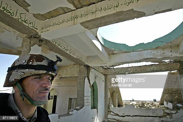 An Iraqi soldier secures a destroyed Shiite mausoleum that was flattened by insurgents in the area in alDor north of Baghdad 17 March 2006 US and...