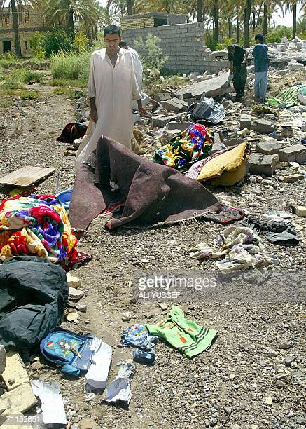 An Iraqi walks among the rubble 08 June 2006 near a one of four houses believed to be destroyed by US forces in the town of Hibhib north of the...